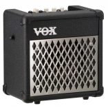 Vox mini5 amp from front angled slightly to one side on black case with a silver metal frontt
